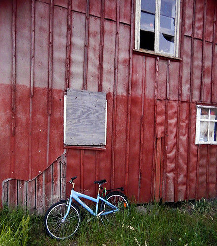 Bike against a red building in Grebbestad, Sweden