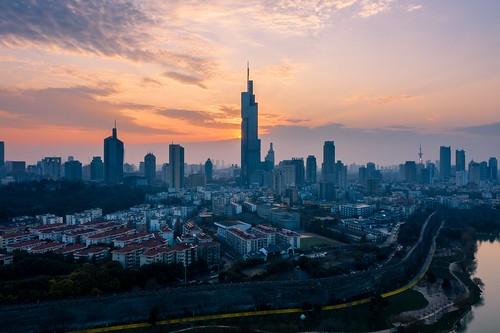 nanjing jiangsu peoplesrepublicofchina city sunset sky urban cloud lake tower skyline skyscraper twilight cityscape aerial drone djimavic2pro