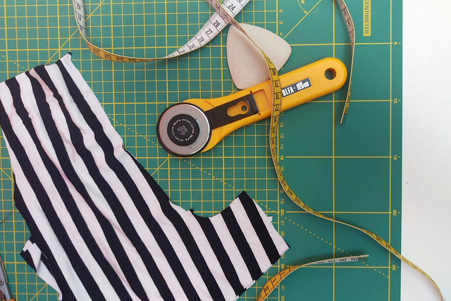Fabric pieces and tools on cutting mat