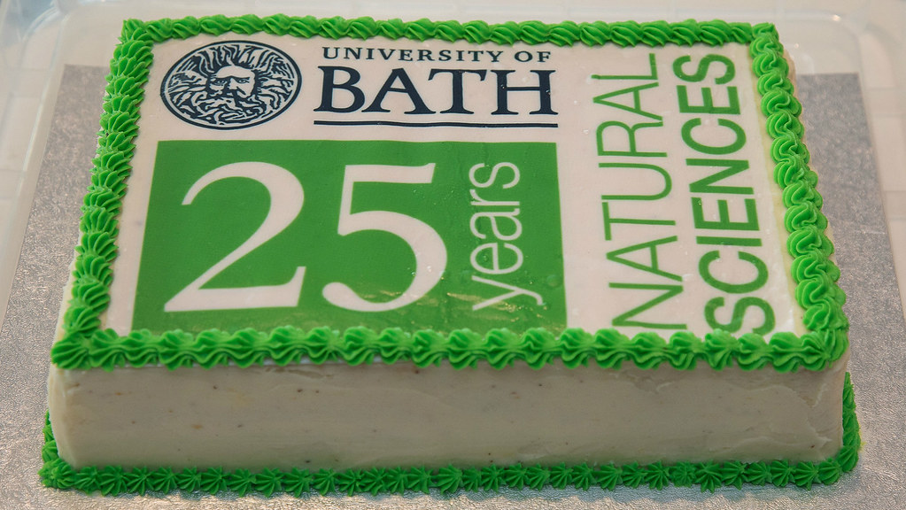 Image of birthday cake commissioned for 25th anniversary, featuring the green and white logo