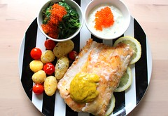 NORTHERN WOLF FISH WITH DILL-MUSTARD SAUCE, GARLIC POTATOES, TSATSIKI & SEAWEED SALAD WITH TROUT-CAVIAR