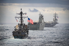 In this file photo, USS McCampbell (DDG 85) sails behind the Royal Australian Navy's HMAS Canberra (L02), USS Key West (SSN 722), and USS Ronald Reagan (CVN 76), during exercise Talisman Sabre 2019. (U.S. Navy/MC2 Markus Castaneda)