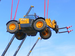 Forklift being moved in the air