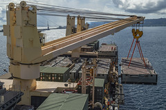 APRA HARBOR, Guam (July 10, 2019) Sailors assigned to Navy Cargo Handling Battalion (NCHB) 1, NCHB 5, and NCHB 13 maneuvers the docking module for the Improved Navy Lighterage System (INLS) over the side of the Military Sealift Command maritime prepositioning force ship USNS 2nd Lt. John P. Bobo (T-AK 3008) during lift on lift off (LOLO operations. The integration of active and reserve Navy Cargo Handling Battalions, Naval Beach Group (NBG) 1, and Maritime Prepositioning Ships Squadron (MPSRON) 3 for INLS (LOLO) and lighterage operations increases Maritime Prepositioning Force (MPF) interoperability, proficiency and theater familiarization in support of any contingency in the Indo-Pacific. (U.S. Navy photo by Mass Communication Specialist 1st Class John Philip Wagner, Jr.)