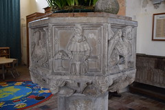 font: seated cleric with a lectern and open book (15th Century)