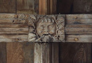 south aisle roof: green man