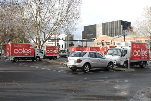Coles Supermarket delivery trucks parked outside the Richmond South 'dark' store