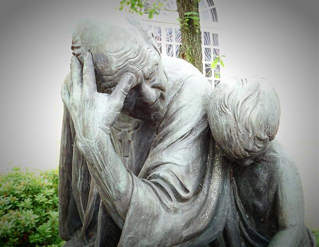 The holy Liborius († 387) with a child (St. Liborius Church, Bremervörde, Germany).