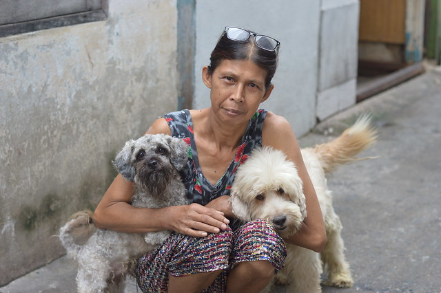 woman with her beloved dogs