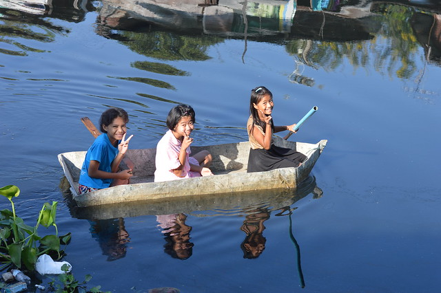 preteen girls in their fiber glass boat