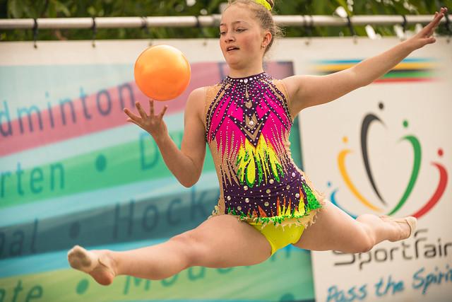 Flying rhythmic gymnastics girl.