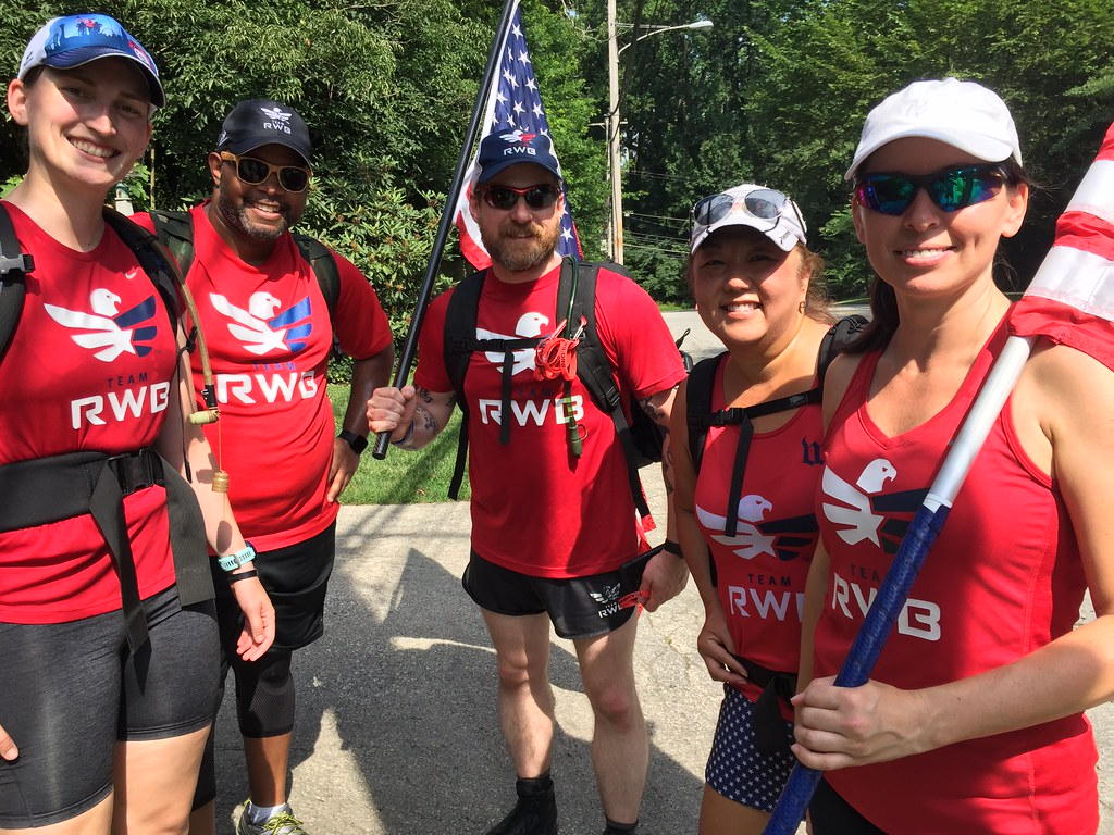 Team RWB Philly ruck marches in woods with weighted bags