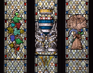 Arms of the de Greys, Barons Walsingham flanked by a vine and a cornstook (1829)