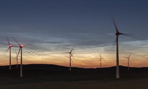 Noctilucent clouds behind Dunmore wind farm