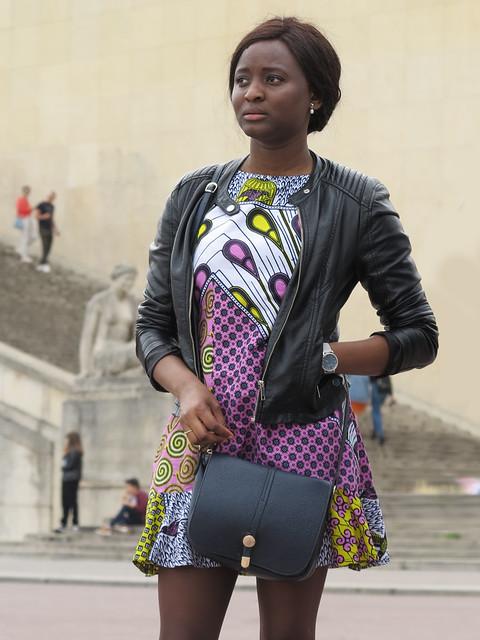Black girl wearing a lively short dress