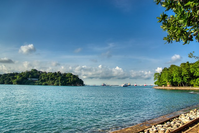 Keppel Bay with view of Sentosa island and ships in the roadstead in Singapore