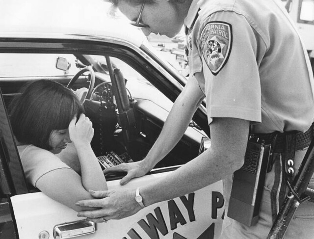 California Highway Patrol Officer shows compassion to accident victim riding in school bus 1989 Los Angeles, CA