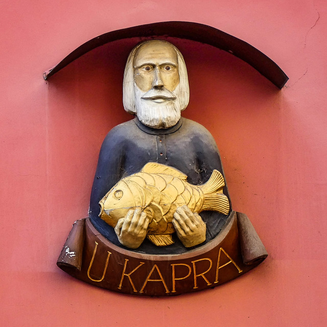 Czech Republic, Prague... statue U Kapra at Karlova St. /old house sign/