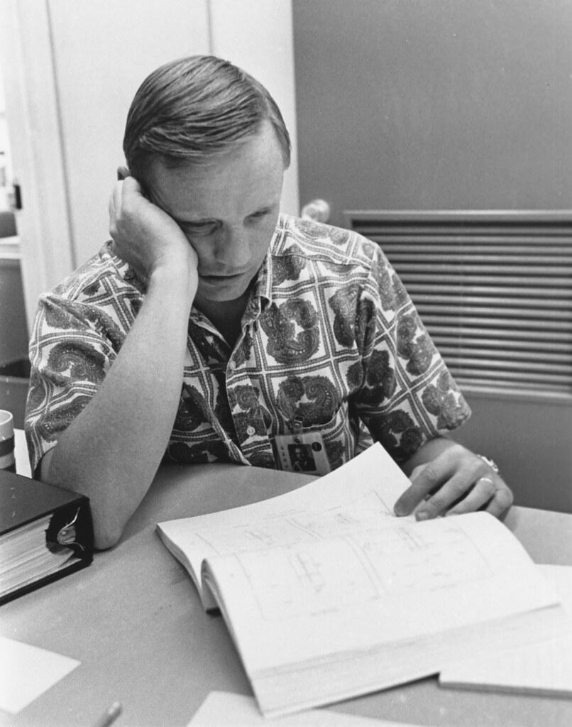 Neil Armstrong reviewing Apollo 11 flight plan