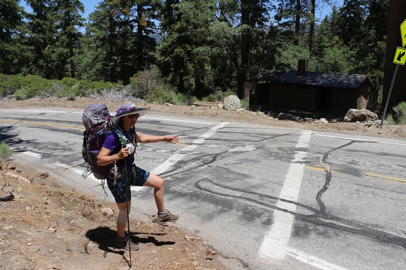 Vicki gets ready to cross Jenks Lake Road at the South Fork Trail trailhead parking area