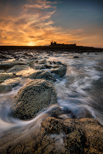 dunstanburghcastle castle northumberland coast sunset rocks watermovement seascape