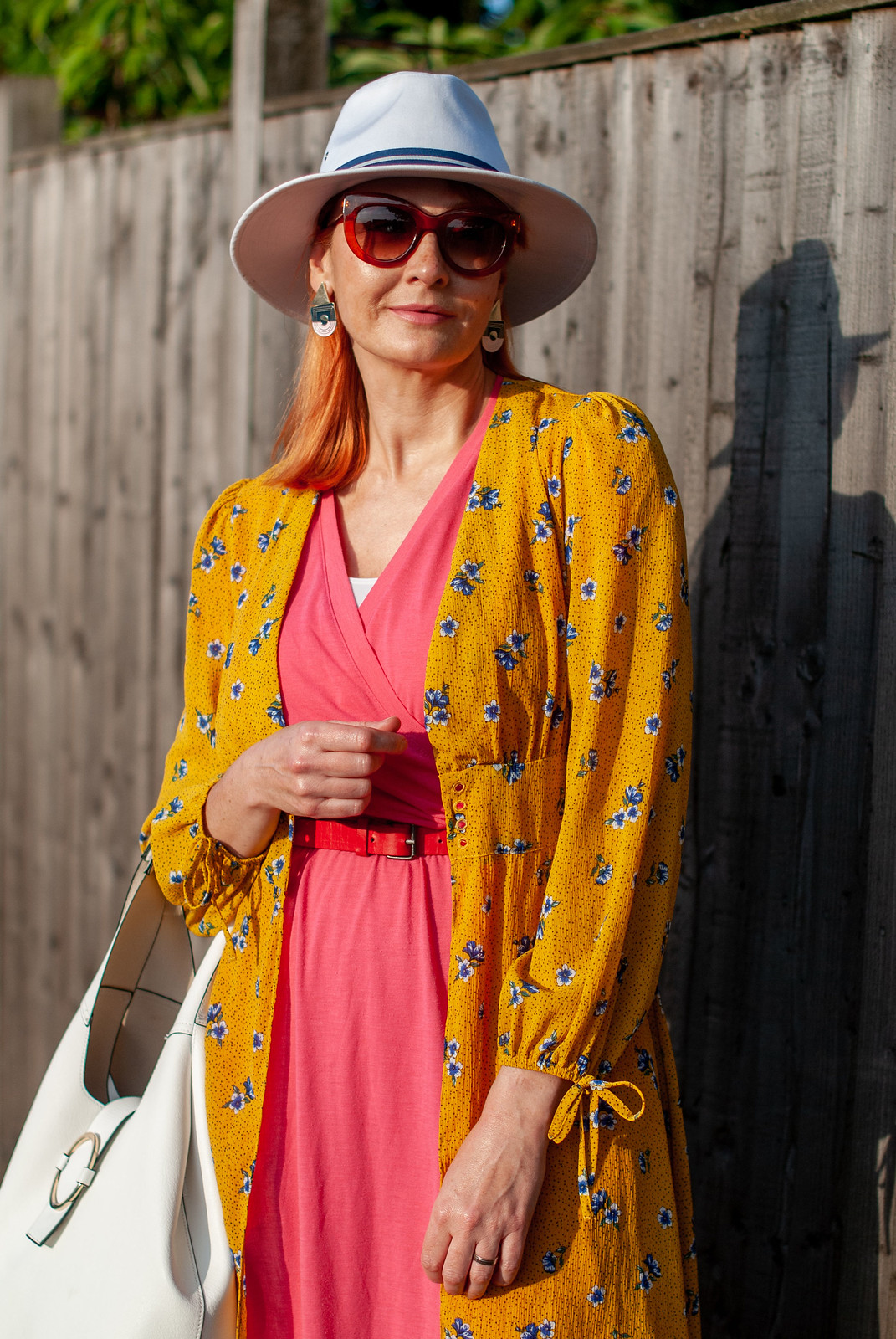 A Pink Cooling Fabric Summer Dress (Perfect For Over 40 and Over 50 Women) With a Yellow Kimono Jacket and White Fedora | Not Dressed As Lamb, Over 40 Style