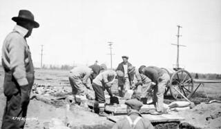 Mixing concrete for the base of the sawmill engine, Relief Project No. 39, Valcartier, Quebec / Malaxage du ciment pour la base du moteur de la scierie, Projet de secours no 39, Valcartier (Québec)