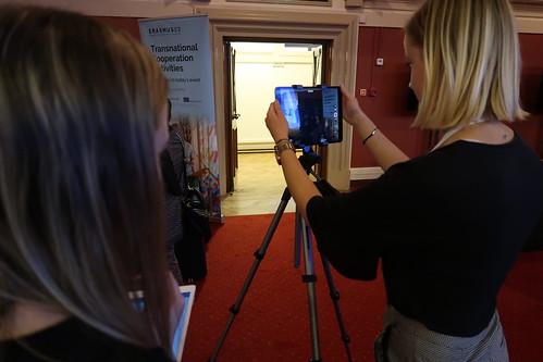 Two Erasmus+ UK staff setting up filming