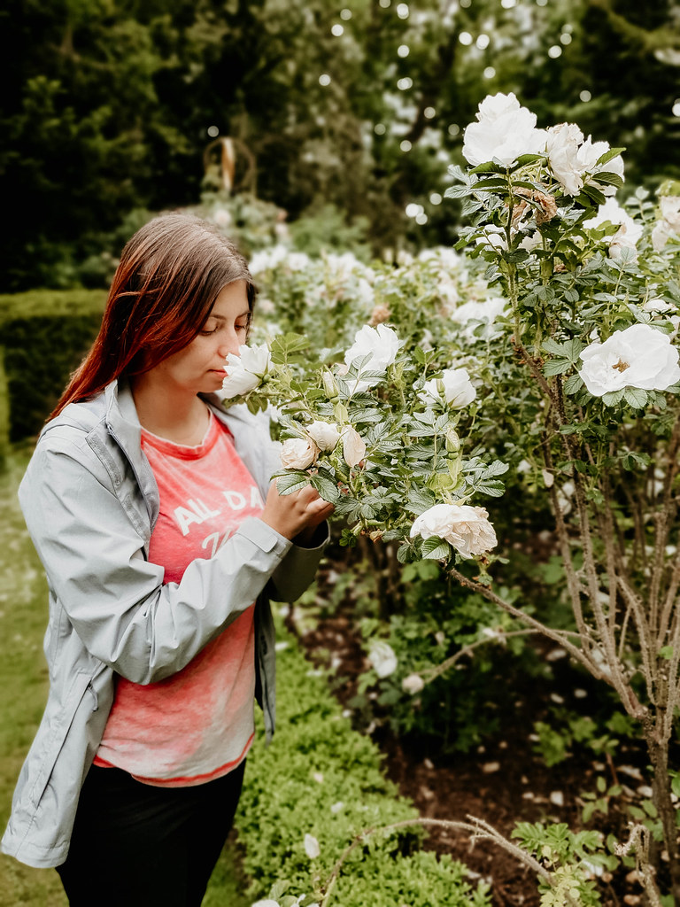 Me smelling a rose in the Rose Garden