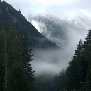 DYNAMIC CLOUDS CLEARING AND REVEALING THE FIRST SNOWFALL OF THE SEASON.  (IN THE MOUNTAINS OF THE NORTH CASCADES,  MANNING,  BC.)