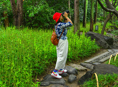 Asian young woman walking at forest