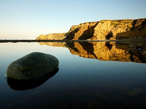 ireland landscape landscapes copper coast reflection water rocks kilfarrasy beach blue ocean sunrise