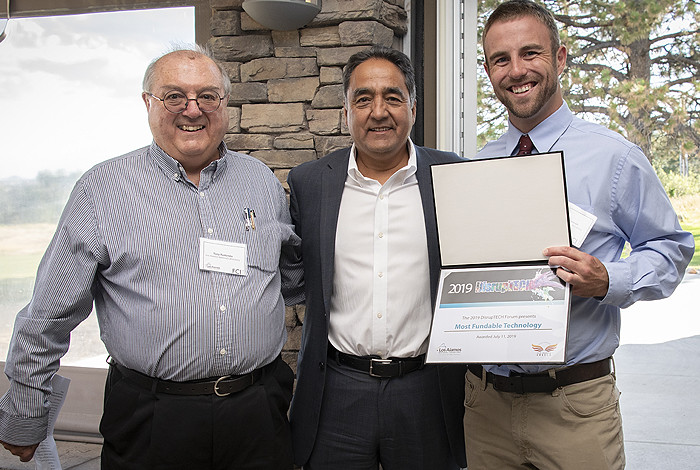 Derrick Kaseman (right) receives his award for Most Fundable Technology from Antonio Redondo (left), director of the Richard P. Feynman Center for Innovation, and John Chavez (center), president of New Mexico Angels.
