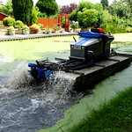 The weed clearing floating 'tractors' are back on the canal at Preston