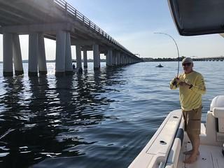 Photo of angler enjoying early morning jigging action at the Bay Bridge.
