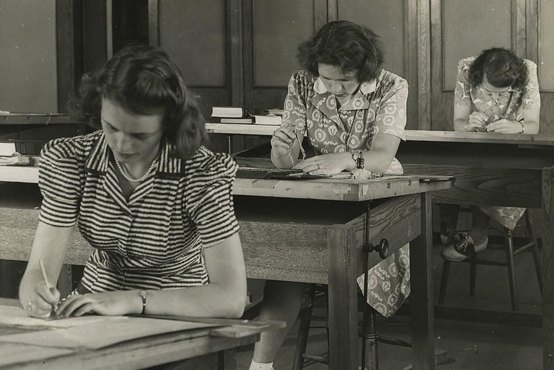 Three women in a classroom