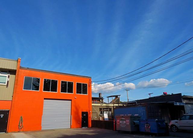 Orange warehouse blue sky