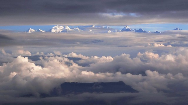 Kanchanjunga range fm Darjeeling partially cover with clouds