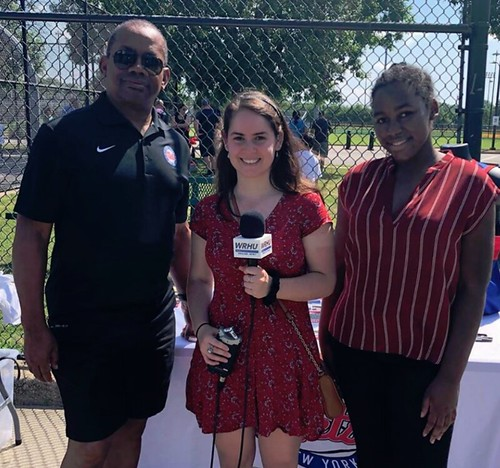 WRHU student journalist (center) with members of the Long Island Nets NBA G league franchise at a community event
