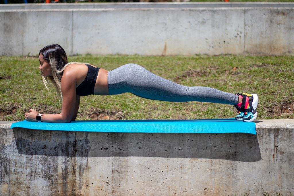 Girl exercising doing a plank