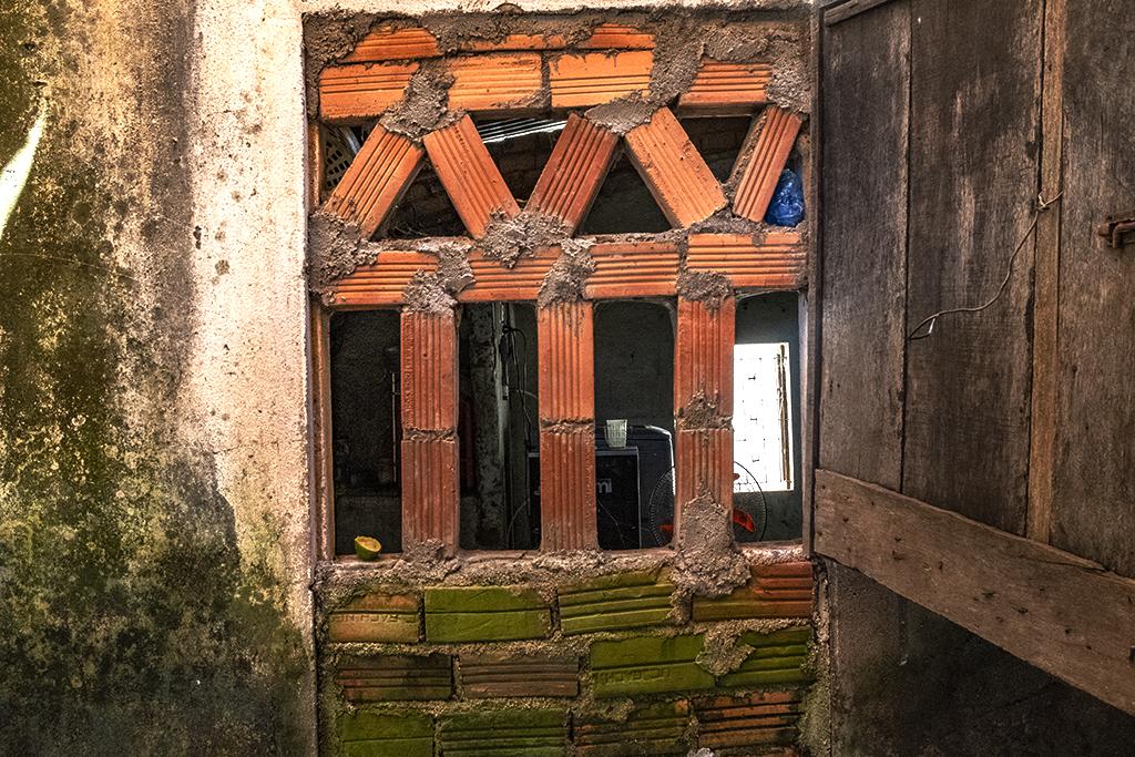 Crude brickwork in window--Hoa Tan
