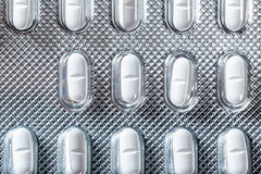 Top view of small white tablets in a package