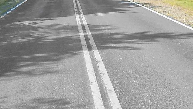 3205 What is the difference between a broken solid yellow and white lines on Roads 03