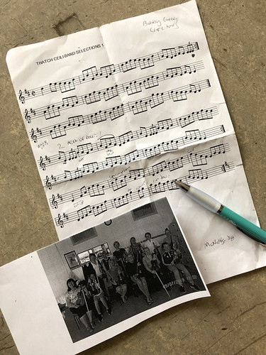 Sheet music, a photocopied picture of my class, and a green pen
