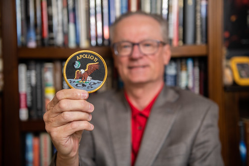 James Hansen holds an Apollo 11 Mission Patch