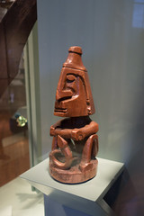 Indonesian carved figure of man with curled penis