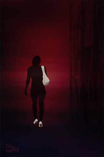Abstract image of the silhouette of a woman walking