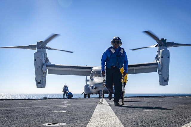 CORAL SEA (July 19, 2019) Gunner's Mate 3rd Class Zion Robinson, from Mobile, Alabama, runs past the foul line on the flight deck after removing chains from an MV-22B Osprey, attached to Marine Medium Tiltrotor Squadron 265 (Reinforced), during flight operations aboard the amphibious dock landing ship USS Ashland (LSD 48). Ashland, part of the Wasp Expeditionary Strike Group, with embarked 31st Marine Expeditionary Unit, is currently participating in Talisman Sabre 2019 off the coast of Northern Australia. A bilateral, biennial event, Talisman Sabre is designed to improve U.S. and Australian combat training, readiness and interoperability through realistic, relevant training necessary to maintain regional security, peace and stability. (U.S. Navy photo by Mass Communication Specialist 2nd Class Markus Castaneda)