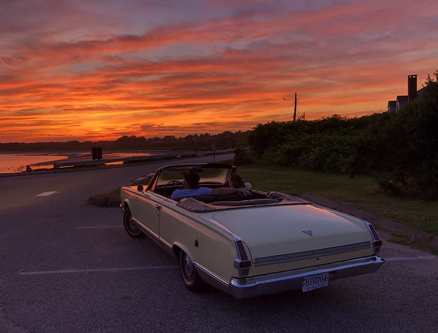 Plymouth Valiant and couple watching the sunset.