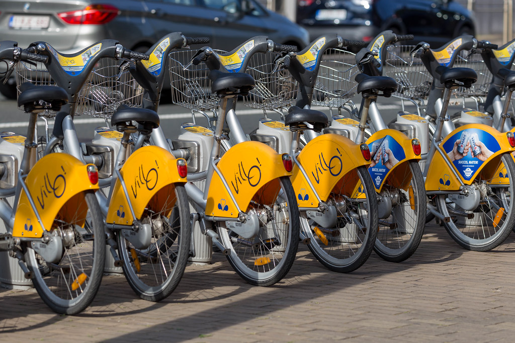 Villo! electric bikes for rent on a street of Brussels, Belgium